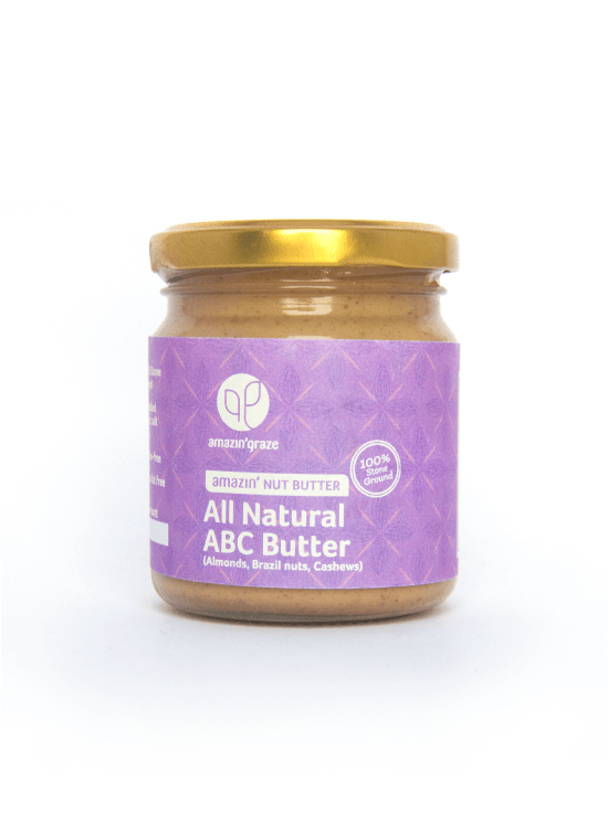 100% stone ground all natural ABC Amazin'Nut Butter, with almonds, brazil nut and cashew, with a purple label