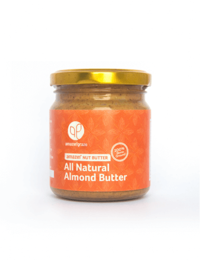 A ramekin of All Natural Almond Butter 100% stone ground being spooned with a knife, next to which is the original yellow labelled pot.