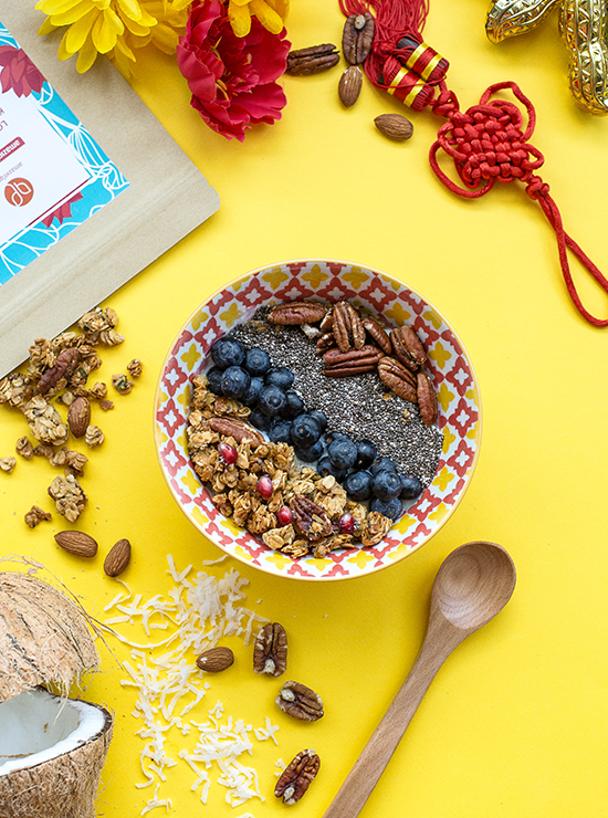 Love Letter Kaya Granola in patterned bowl on yellow background